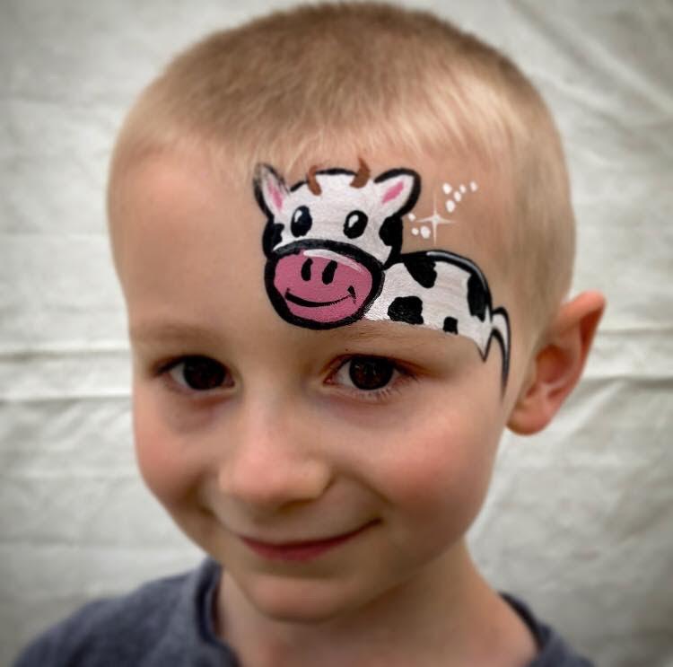 An over the eye little cow face paint