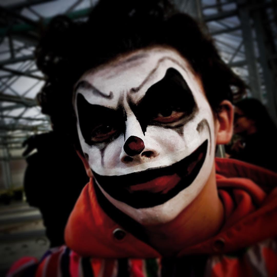 Dark sunken clown eyes and a creepy buffed smile
