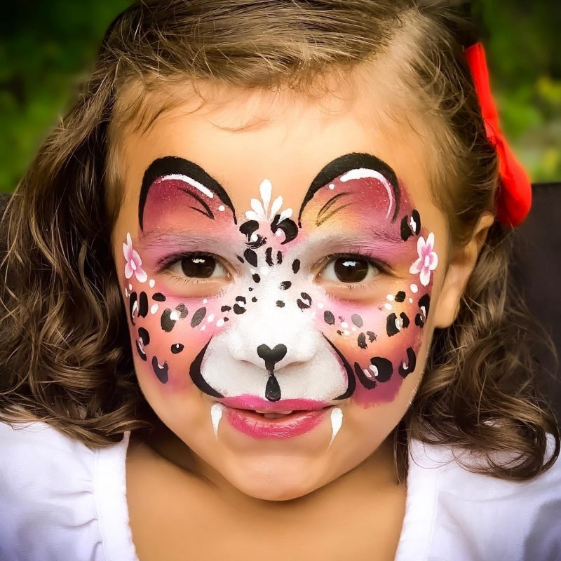 A pink kitten face painting